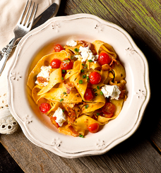 Fettuccine with tomatoes, pancetta and goat cheese